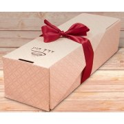 Wine and Chocolate Pralines in Wooden Gift Basket