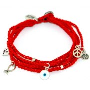 Six strand woven red string bracelet with selection of charms